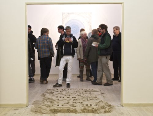 The sand installation was placed at the entrance of the gallery